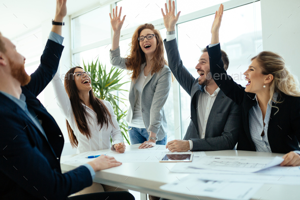 Happy business people celebrating success - Stock Photo - Images