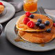 pancakes with blueberry raspberry honey and jam for breakfast - PhotoDune Item for Sale