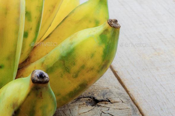 Banana on wood - Stock Photo - Images
