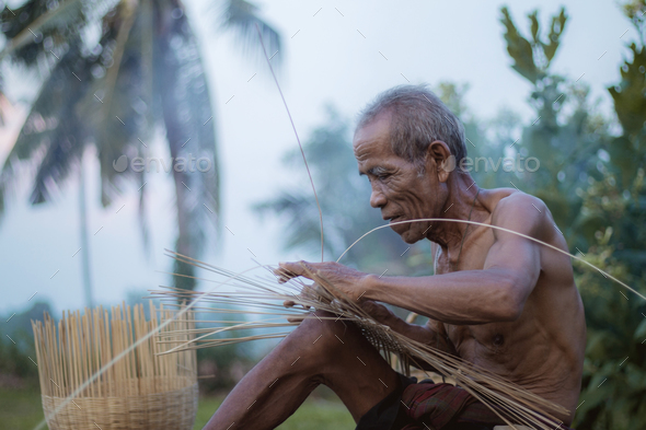 Ole man are weaving on field - Stock Photo - Images