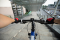 Riding bike going down the stairs of overpass - PhotoDune Item for Sale