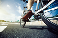 Legs cycling on highway - PhotoDune Item for Sale