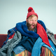 Bearded Man with Flue Sitting on Sofa at Home. Healthcare Concepts. - PhotoDune Item for Sale