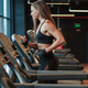 sporty female run on treadmill in gym - PhotoDune Item for Sale