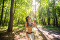 Young woman drinking water after running outdoors - PhotoDune Item for Sale