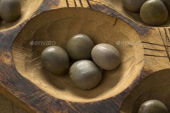 Traditional African oware game with seeds - Stock Photo - Images
