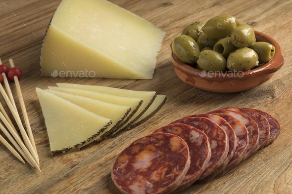Spanish Manchego cheese, Chorizo sausage and olives - Stock Photo - Images