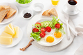healthy breakfast with fried eggs, avocado, tomato, toasts and c - PhotoDune Item for Sale