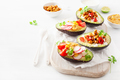 avocado boats stuffed with hummus, tomatoes, radish, roasted chi - PhotoDune Item for Sale