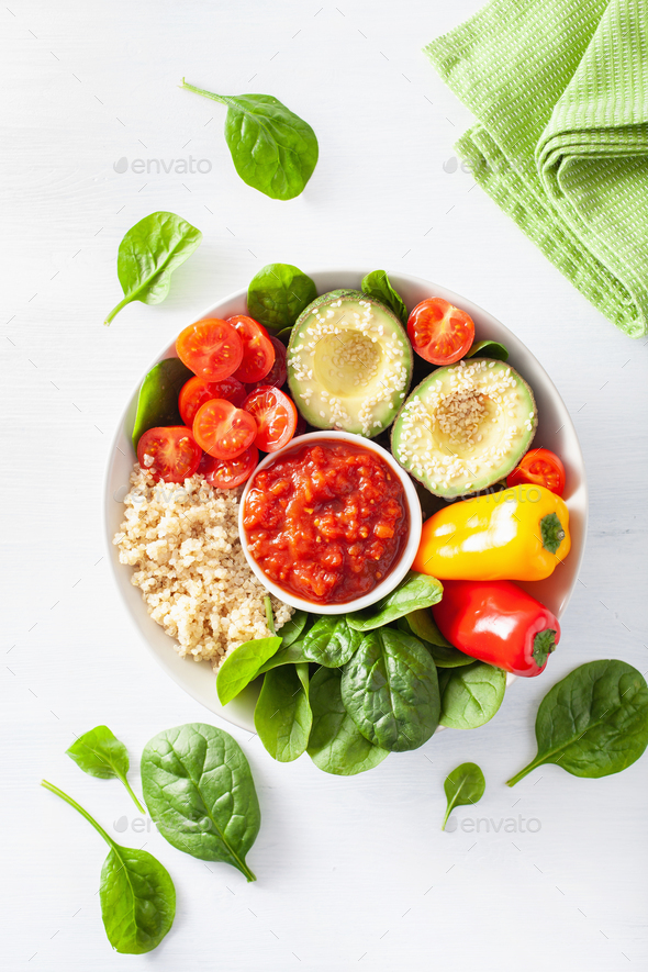 vegan buddha bowl. healthy lunch bowl with avocado, tomato, bell - Stock Photo - Images