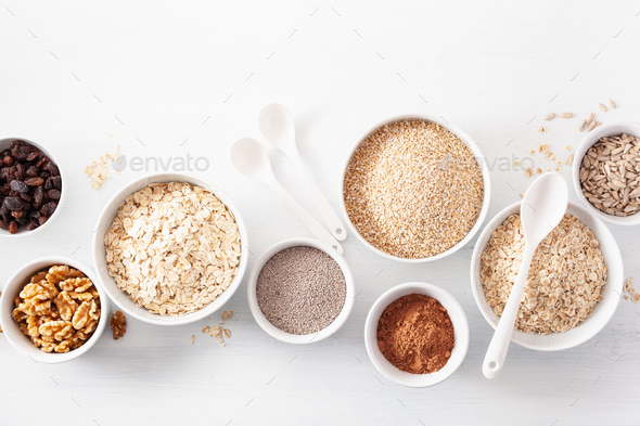 variaty of raw cereals and nuts for breakfast. Oatmeal flakes an - Stock Photo - Images