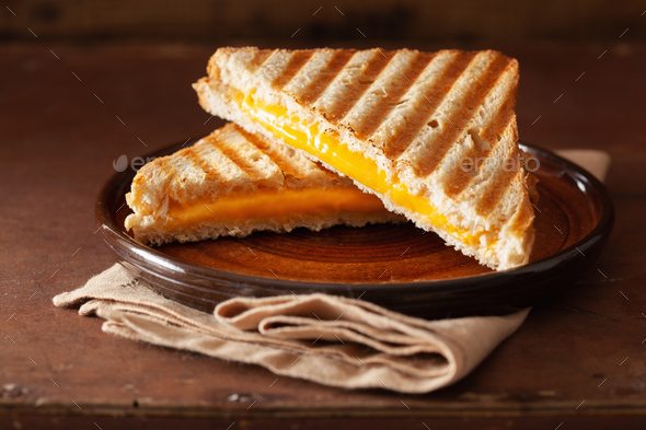 grilled cheese sandwich on rustic brown background - Stock Photo - Images