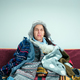 The young woman with Flue Sitting on Sofa at Home. Healthcare Concepts. - PhotoDune Item for Sale