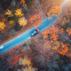 Aerial view of road with blurred car in autumn forest at sunset - PhotoDune Item for Sale