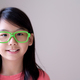 Portrait of Asian teenager with big green glasses - PhotoDune Item for Sale
