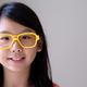 Portrait of Asian teenager with big yellow glasses - PhotoDune Item for Sale