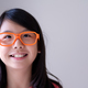 Portrait of Asian teenager with big orange glasses - PhotoDune Item for Sale