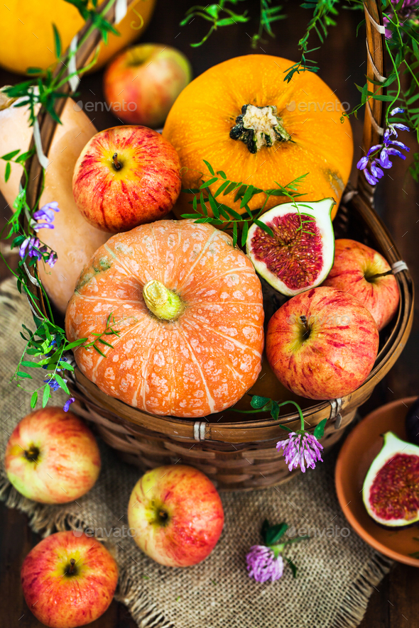 Autumnal colorful  pumpkins, apples and figs  on rustic backgrou - Stock Photo - Images