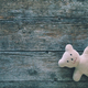 Adorable teddy bear on toned wooden background. Space for text - PhotoDune Item for Sale