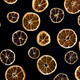 Abstract background of dried orange slices on black - PhotoDune Item for Sale