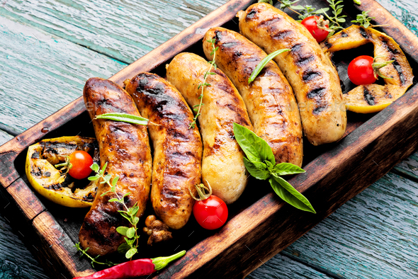 Grilled sausages on cutting board - Stock Photo - Images