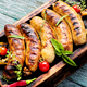 Grilled sausages on cutting board - PhotoDune Item for Sale