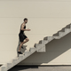 Full length shot of healthy athletic man climbing up on stairs. - PhotoDune Item for Sale