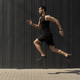 A side view shot of a fit young, athletic man jumping and running - PhotoDune Item for Sale