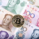 Bitcoin coin on the background of Chinese banknotes  - PhotoDune Item for Sale