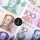 Yuan coin on the background of banknotes  - PhotoDune Item for Sale