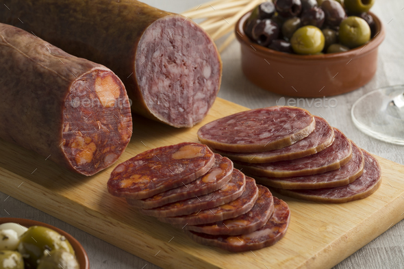 Traditional piece of Spanish Salchichon sausage and chorizo - Stock Photo - Images