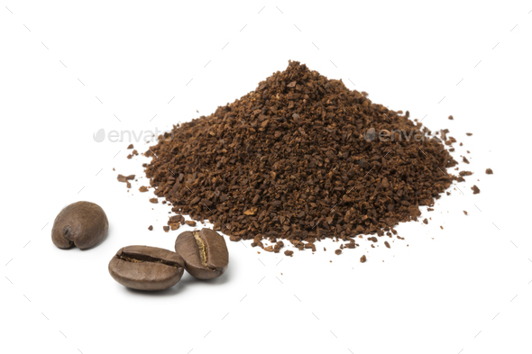 Heap of ground coffee and some coffee beans - Stock Photo - Images