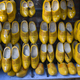 Pairs of yellow wooden shoes in a shop hanging on a wall - PhotoDune Item for Sale
