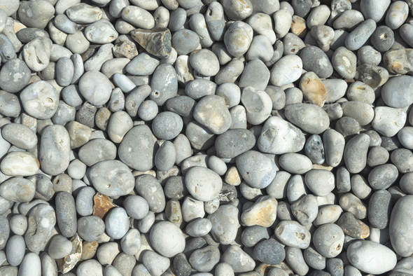 All rounded tiny pebbles from beach a natural summer background smooth polished pebble stones - Stock Photo - Images