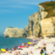 Blured image of summer beach with seashore people and mountain cliffs - PhotoDune Item for Sale