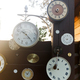 Collection of vintage clock hanging on an old wooden wall on the outdoors with sunshine - PhotoDune Item for Sale