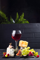 Grape, cheese, figs and honey with a glasses of red on a stone black background - PhotoDune Item for Sale