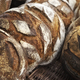 Rustic bread on wicker baskets in a bakery - PhotoDune Item for Sale