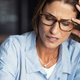 Stressed woman wearing eyeglasses - PhotoDune Item for Sale