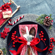 Christmas decoration. Festive plate and cutlery with Christmas decoration. Christmas background - PhotoDune Item for Sale