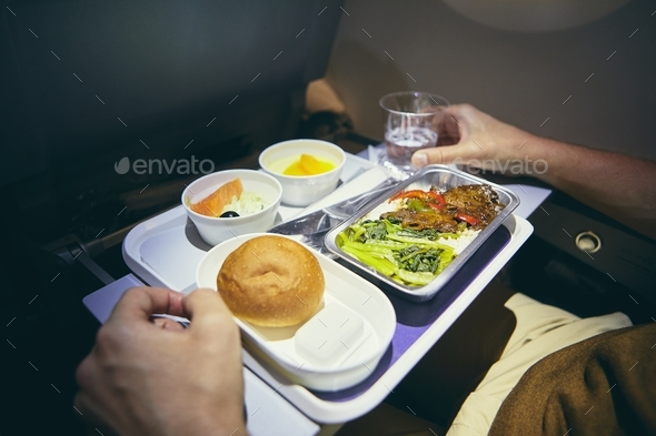 Dinner in economy class - Stock Photo - Images