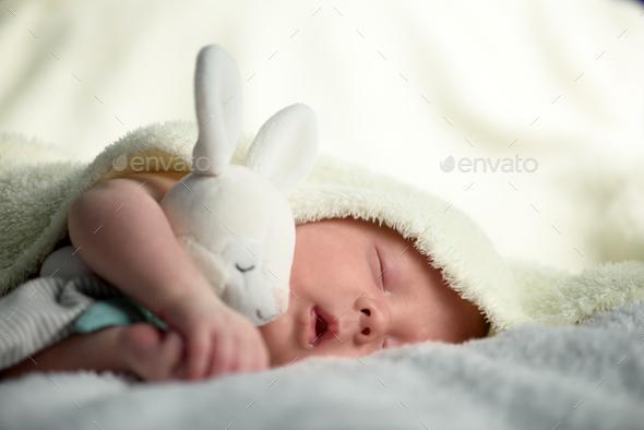 Newborn baby boy on white carpet closeup - Stock Photo - Images