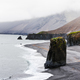 Alone basalt rock on Iceland coastline - PhotoDune Item for Sale
