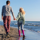 Loving young couple on a beach at autumn sunny day - PhotoDune Item for Sale