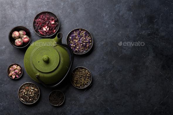 Various dry tea and tea pot - Stock Photo - Images