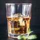 Glass of rum on the dark background - PhotoDune Item for Sale