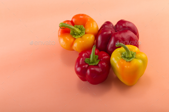 Sweet bellpepper on a colored background. Studio light. Top view - Stock Photo - Images
