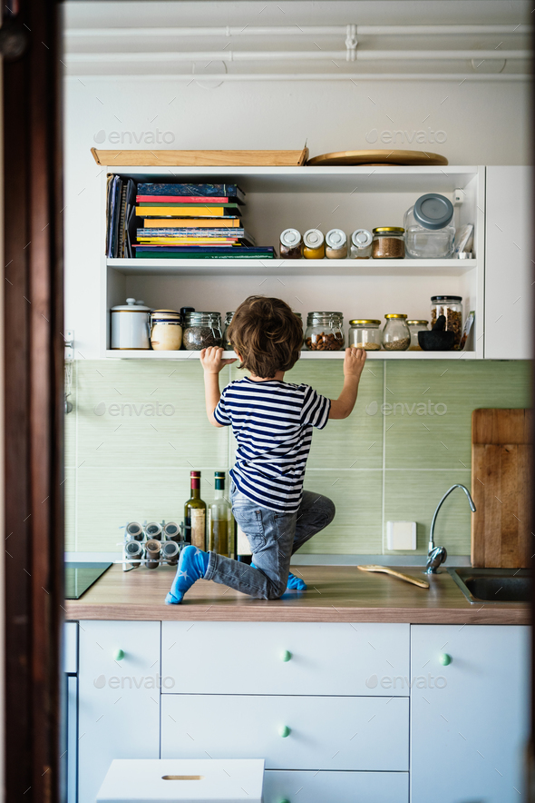 Boy in kitchen  - Stock Photo - Images
