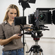 Beautiful woman operating a video camera rig - PhotoDune Item for Sale