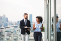 A portrait of two businesspeople standing against London view panorama. - PhotoDune Item for Sale